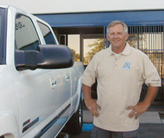 A picture of the owners in front of the company van
